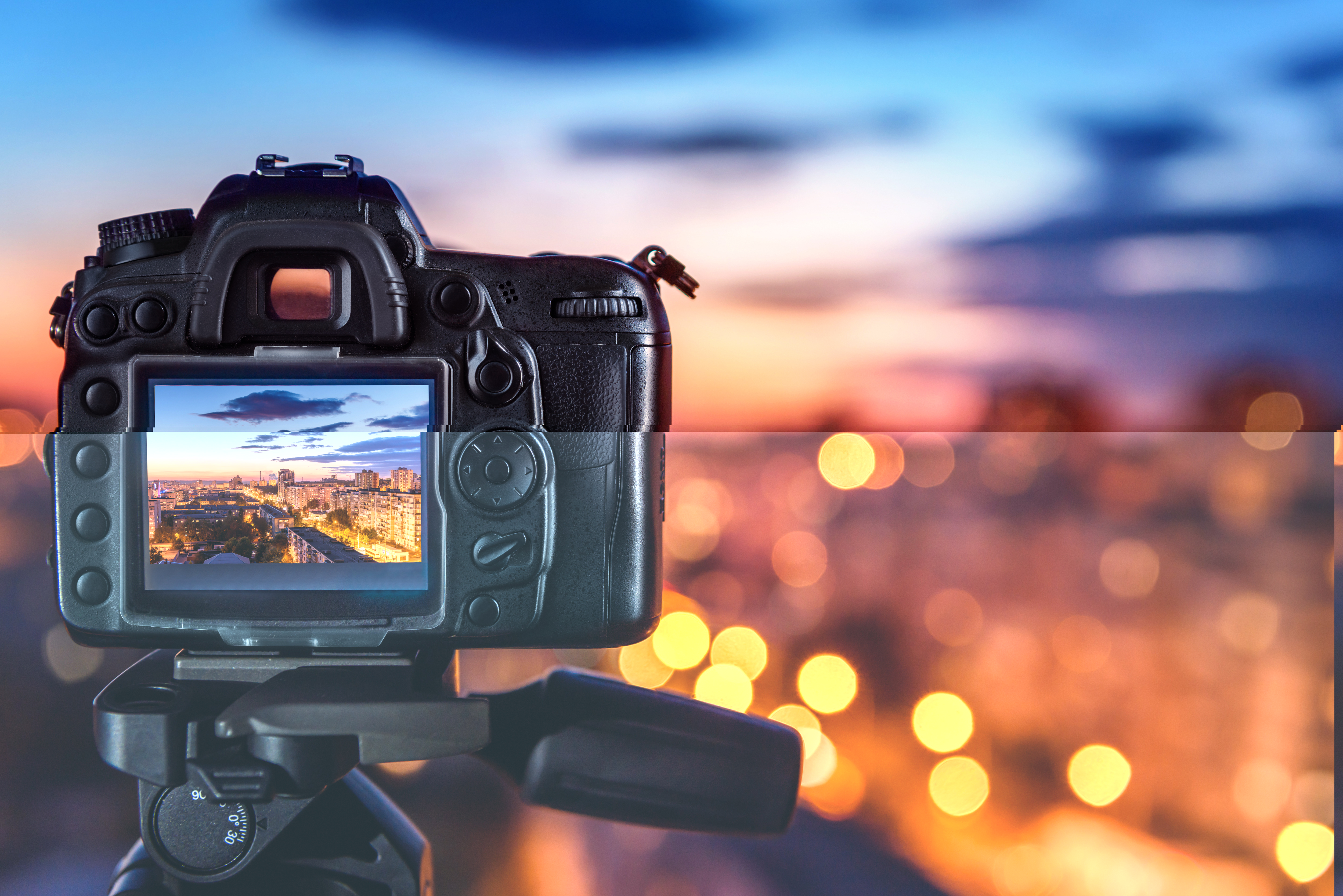 this is an image of a camera looking on to a sunset with lights
