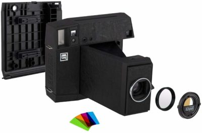 This is an image of a black LOMO instant camera bundle kit.