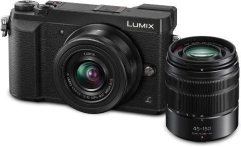 This is an image of a black Panasonic LUMIX GX85 4K Digital Camera with 12-32mm and 45-150mm Lens, 16 Megapixel sensor and 3-Inch Tilt and Touch LCD,