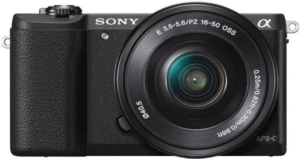 This is an image of a black Sony a5100 camera with 16-50mm Lens and 3-Inch Flip Up LCD