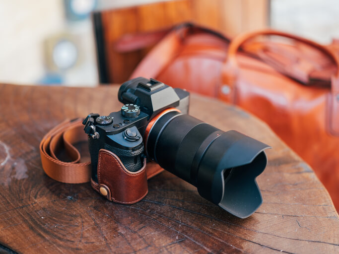 Digital mirrorless camera on a desk with a large lens