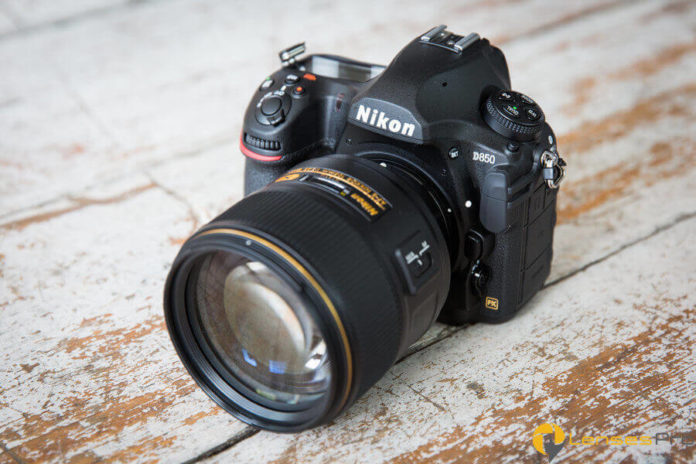 Nikon D850 digital camera with a large lens attached to mainbody