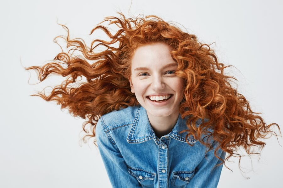 Portrait photo of a smiling redhead girl