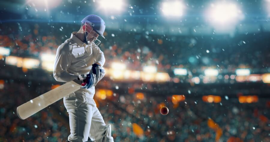 Picture of a cricket batsman about to strike the ball