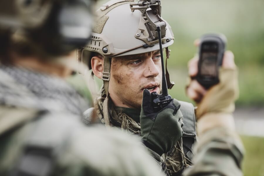 Two soldiers exchanging communication